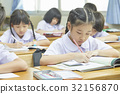 students are writting in class with concentration 32156870