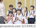 happy students are saluting teacher by put the hands together 32156913