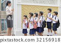 a photo of teacher welcoming students at school in Thai style 32156918