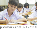 children are sitting in the class and learning. 32157118