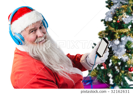 Santa claus listening to music on mobile phones 32162631