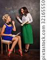 Teacher and student at blackboard 32165550