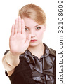 Businesswoman showing stop hand sign gesture 32168609