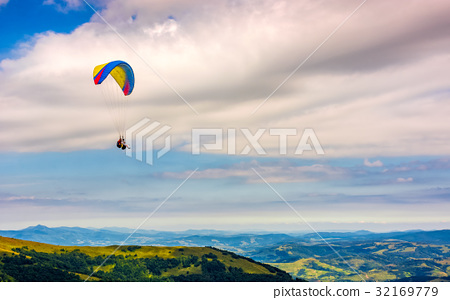 Skydiving  extreme over the mountains 32169779