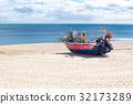 Stranded boat in the beach of Salema (Portugal) 32173289