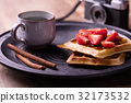 strawberries waffles served with cofee 32173532