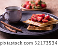 strawberries waffles served with cofee 32173534