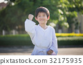 Asian child in white kimono during training karate 32175935