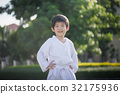 Asian child in white kimono during training karate 32175936
