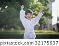Asian child in white kimono during training karate 32175937