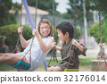 Asian mother and her son swinging on 32176014