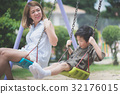 Asian mother and her son swinging on 32176015