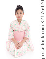 Asian girl in Japanese Traditional Dress sitting 32176020