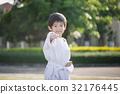 Asian child in white kimono during training karate 32176445