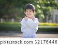 Asian child in white kimono during training karate 32176446