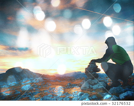 Film grain effect  Alone man is stocking pyramid - Stock Photo