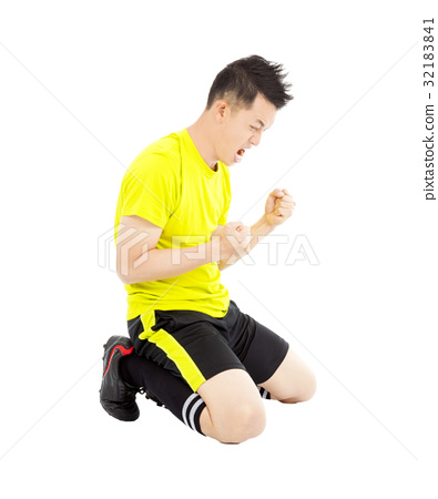 young soccer player make a fist and  yell 32183841