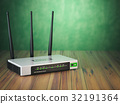 Wi-Fi wireless internet router on the wooden table 32191364
