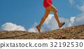 Detail of woman's legs walking athlete in mountain 32192530