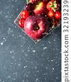 Fresh fruit in supermarket cart on black. Vertical 32193239