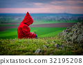 girl with Red Riding Hood costume in the nature 32195208