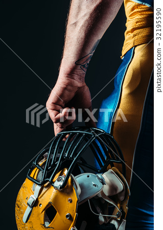 Male person in uniform with football helmet 32195590