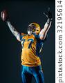 American football player in uniform and helmet 32195614