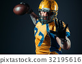 American football offensive player with ball 32195616