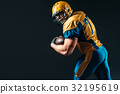 American football offensive player with ball 32195619