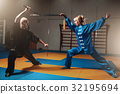 Wushu fighters, man and woman with swords 32195694
