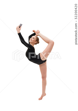 Gymnast performing and taking photo on phone 32200420