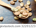 Spoon of dried beans on a wooden background. 32201223