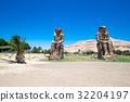 The Colossi of Memnon - two massive stone statues 32204197