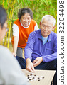 seniors play traditional chinese board game Go 32204498