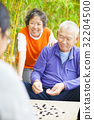 seniors play weiqi with friends in the park 32204500