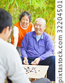 "male seniors win a chinese board game .""weiqi"" 32204501"