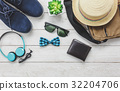 Top view accessoires to travel with man clothing. 32204706