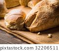 Freshly baked bread burlap dark wooden background 32206511