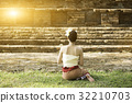 Asian lady in custom sit in front of old stupa 32210703