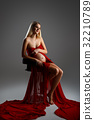 Pregnant girl in red dress 32210789