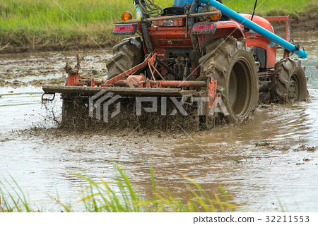 Tractor working on rice field 32211553