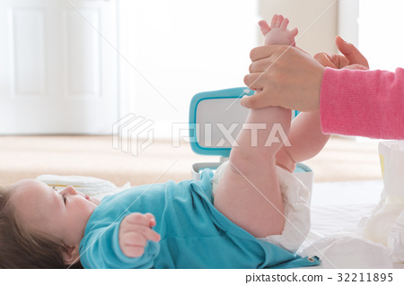 Baby boy being cared for by his mother 32211895