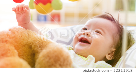 Baby boy playing with his toy 32211918