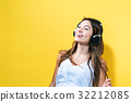 Happy young woman with headphones 32212085