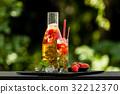 Homemade strawberry ice tea in the garden 32212370