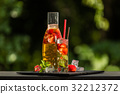 Homemade strawberry ice tea in the garden 32212372