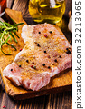Raw pork slices prepared for roast with spices 32213965