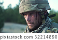 Wounded soldier in uniform 32214890