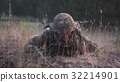 Soldier crawling in field 32214901