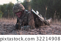 Soldier crawling in field 32214908